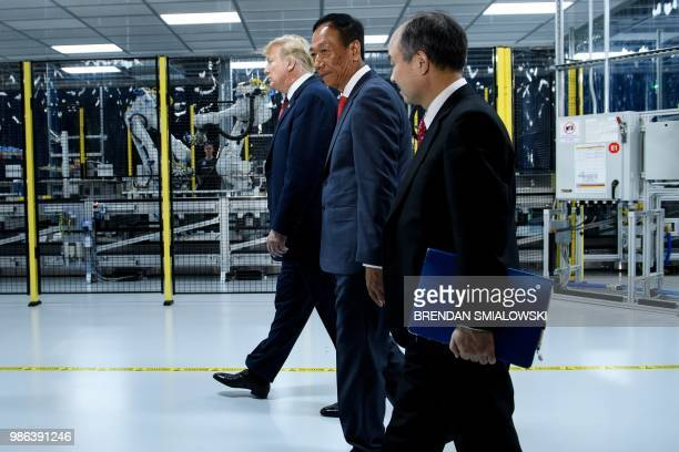 US President Donald Trump Foxconn Chairman Terry Gou and Masayoshi Son Chief Executive Officer of SoftBank tour a Foxconn facility at the Wisconsin...