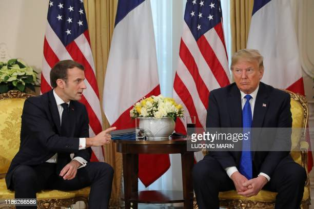 President Donald Trump France's President Emmanuel Macron react as they talk during their meeting at Winfield House London on December 3 2019 NATO...