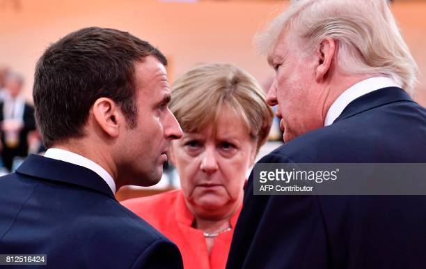 President Donald Trump French President Emmanuel Macron and German Chancellor Angela Merkel chat at the start of the first working session of the G20...