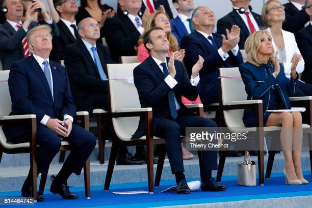 President Donald Trump French President Emmanuel Macron and his wife Brigitte Trogneux attend the traditional Bastille day military parade on the...