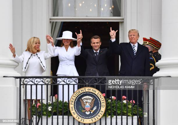 President Donald Trump French President Emmanuel Macron US First Lady Melania Trump and French First Lady Brigitte Macron are seen on the balcony at...
