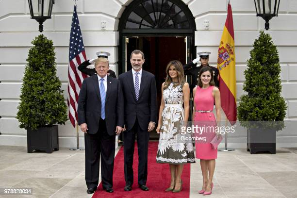 US President Donald Trump from left Felipe VI Spain's king First Lady Melania Trump and Queen Letizia stand for photographers at the South Portico of...