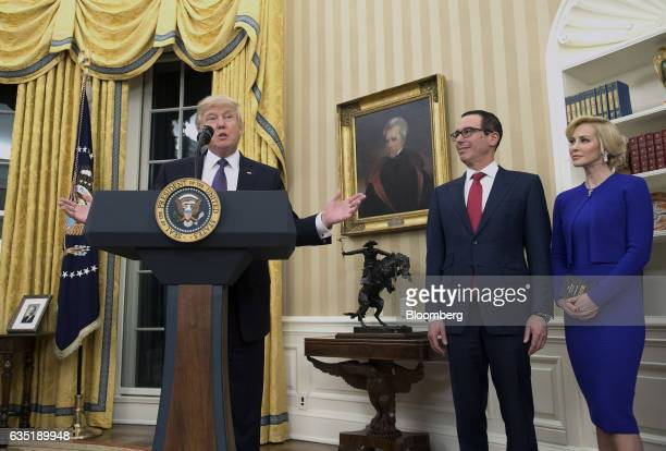 US President Donald Trump from left speaks as Steven Mnuchin US Treasury secretary and his fiancee Louise Linton listen during a swearingin ceremony...