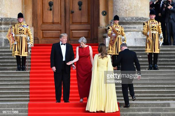 US President Donald Trump from left Theresa May UK prime minister US First Lady Melania Trump and Philip May husband of May arrive to watch a live...