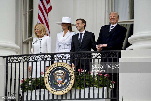 S President Donald Trump from right Emmanuel Macron France's president US First Lady Melania Trump and Brigitte Macron France's first lady stand on...