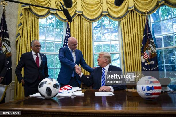 US President Donald Trump from right shakes hands with Gianni Infantino president of FIFA as Carlos Cordeiro president of the United States Soccer...
