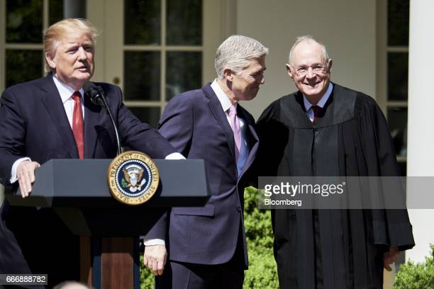 US President Donald Trump from right speaks while Judge Neil Gorsuch and Associate Justice Anthony Kennedy smile during the swearing in ceremony of...