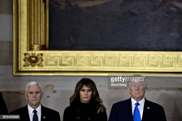 US President Donald Trump from right US First Lady Melania Trump and US Vice President Mike Pence attend a service for the late Reverend Billy Graham...