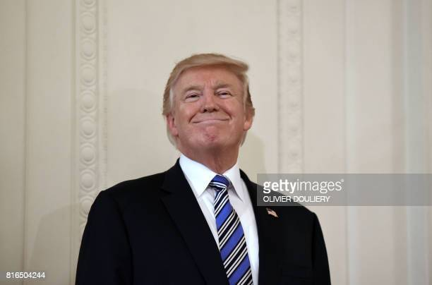 President Donald Trump geestures during a Made in America product showcase event in the East Room of the White House in Washington DC on July 17 2017