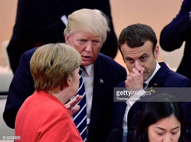 S President Donald Trump German Chancellor Angela Merkel and French President Emmanuel Macron speak together when they arrive for the first woriking...