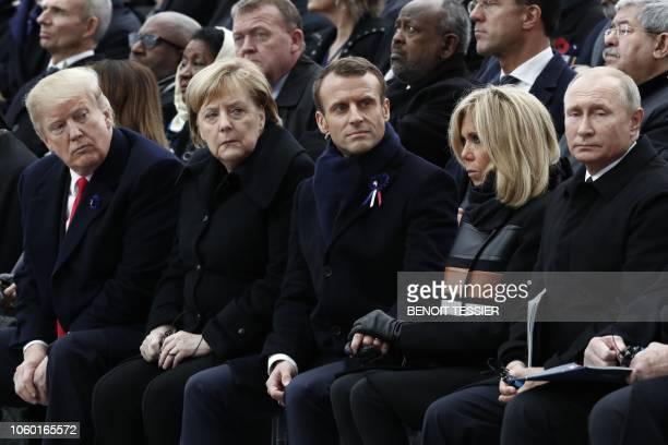 US President Donald Trump German Chancellor Angela Merkel French President Emmanuel Macron and his wife Brigitte Macron and Russian President...