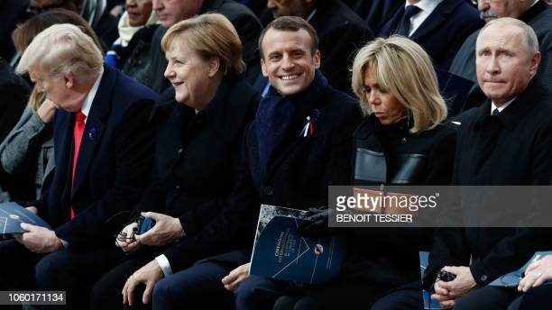 US President Donald Trump German Chancellor Angela Merkel French President Emmanuel Macron French President's wife Brigitte Macron and Russian...