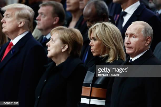 US President Donald Trump German Chancellor Angela Merkel French President's wife Brigitte Macron and Russian President Vladimir Putin attend a...
