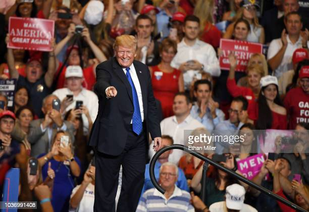 S President Donald Trump gestures after speaking during a campaign rally at the Las Vegas Convention Center on September 20 2018 in Las Vegas Nevada...