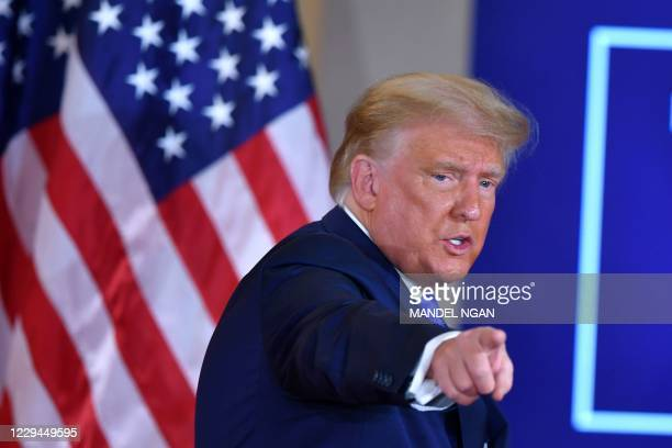 President Donald Trump gestures after speaking during election night in the East Room of the White House in Washington, DC, early on November 4, 2020.
