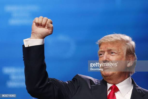 S President Donald Trump gestures after speaking during the annual American Farm Bureau Federation conference in Nashville Tennessee US on Monday Jan...