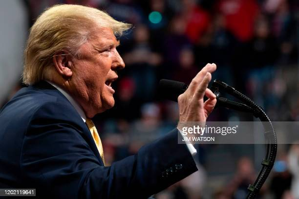 "President Donald Trump gestures as he addresses a ""Keep America Great"" rally in Colorado Springs, Colorado, on February 20, 2020."