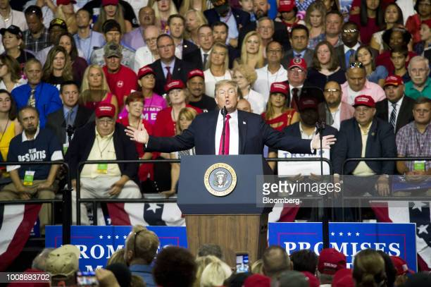 US President Donald Trump gestures as he addresses the crowd during a rally in Tampa Florida US on Tuesday July 31 2018 Iranian Foreign Minister...