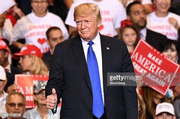 US President Donald Trump gestures as he arrives at a rally in Las Vegas Nevada US on Thursday Sept 20 2018 Trump continued to hit out at China days...