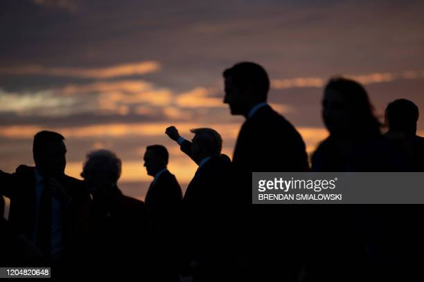 President Donald Trump gestures as he arrives at Douglas International Airport March 2 in Charlotte North Carolina US President Donald Trump holds a...
