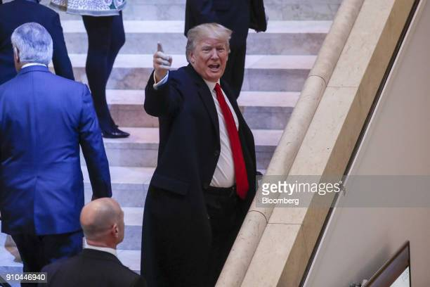 US President Donald Trump gestures as he arrives at the Congress Center on the closing day of the World Economic Forum in Davos Switzerland on Friday...