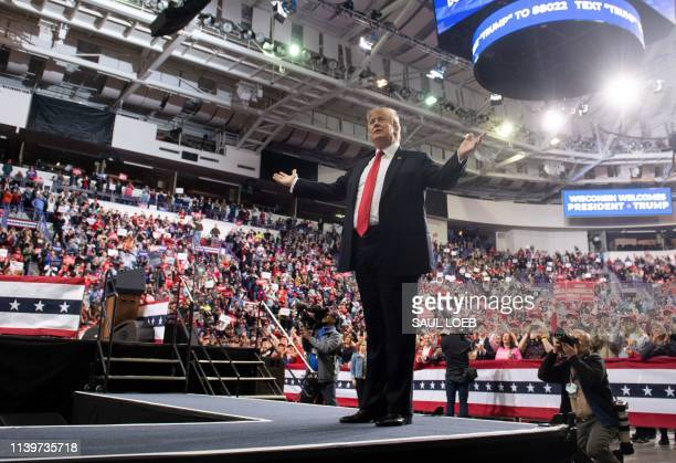 US President Donald Trump gestures as he arrives for a Make America Great Again rally in Green Bay Wisconsin April 27 2019