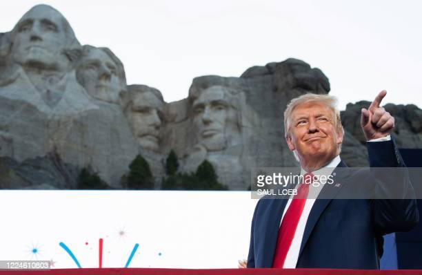 US President Donald Trump gestures as he arrives for the Independence Day events at Mount Rushmore National Memorial in Keystone South Dakota July 3...