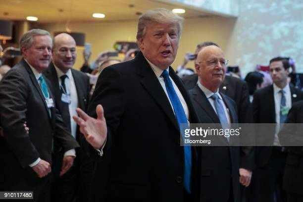 US President Donald Trump gestures as he arrives on day three of the World Economic Forum in Davos Switzerland on Thursday Jan 25 2018 World leaders...