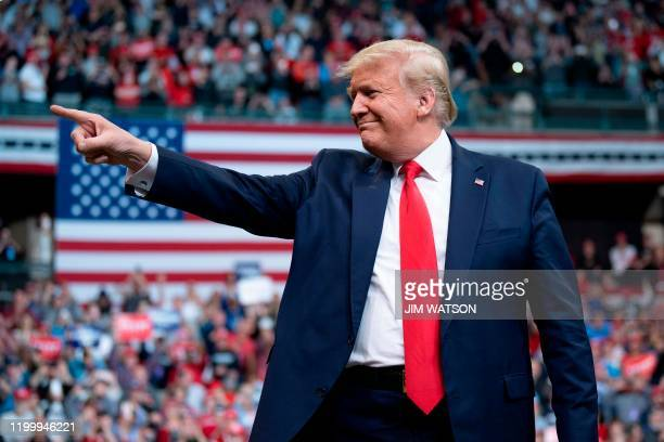 US President Donald Trump gestures as he arrives to speak during a rally in Manchester New Hampshire on February 10 2020