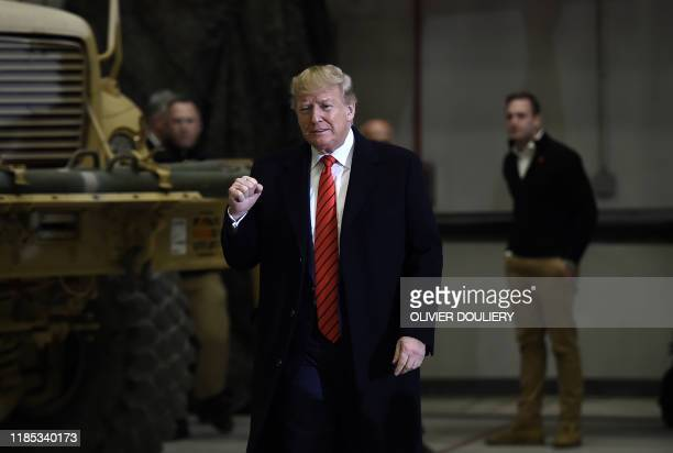 President Donald Trump gestures as he arrives to speak to the US soldiers during a surprise Thanksgiving day visit at Bagram Air Field, on November...