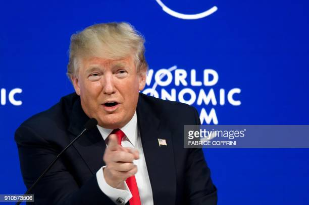 US President Donald Trump gestures as he delivers a speech during the World Economic Forum annual meeting on January 26 2018 in Davos eastern...