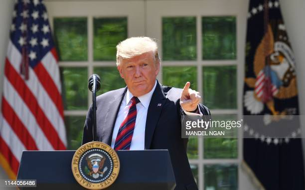 President Donald Trump gestures as he delivers remarks on immigration at the Rose Garden of the White House in Washington DC on May 16 2019 President...