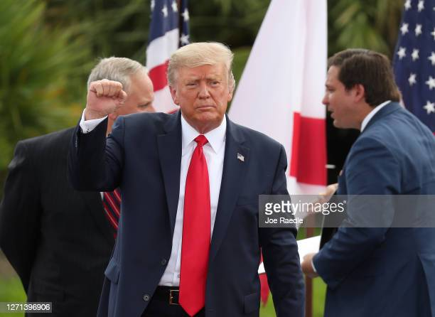 President Donald Trump gestures as he leaves after speaking about the environment during a stop at the Jupiter Inlet Lighthouse on September 08 2020...