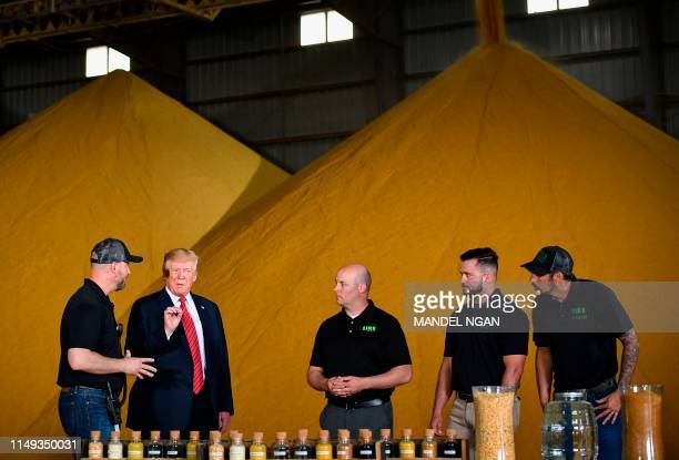 US President Donald Trump gestures as he looks at corn samples used in biofuels at Southwest Iowa Renewable Energy in Council Bluffs Iowa on June 11...
