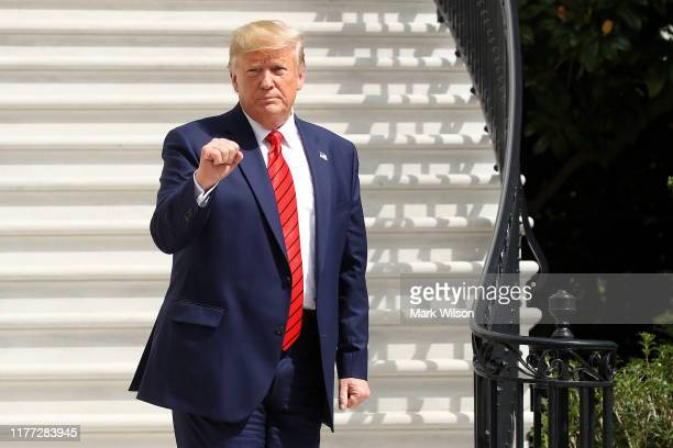 S President Donald Trump gestures as he returns to the White House after attending the United Nations General Assembly on September 26 2019 in...