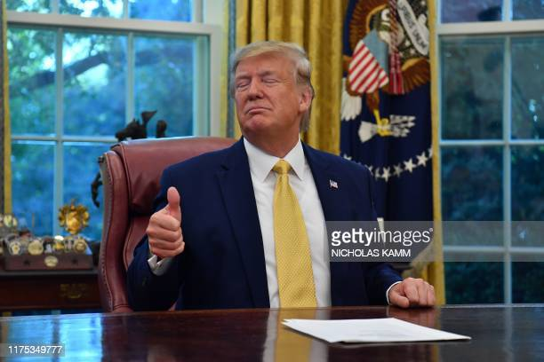US President Donald Trump gestures as he speaks after announcing and initial deal with China while meeting the special Envoy and Vice Premier of the...