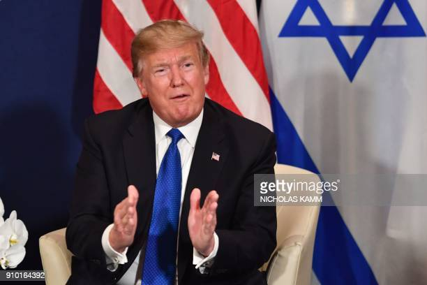 US President Donald Trump gestures as he speaks during a bilateral meeting with Israel's Prime Minister on the sidelines of the World Economic Forum...