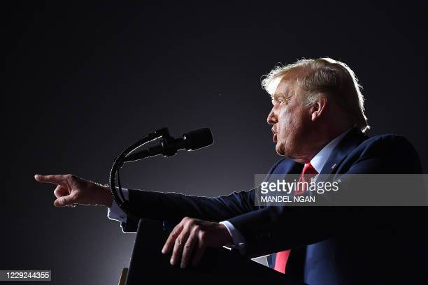 President Donald Trump gestures as he speaks during a campaign rally at Pensacola International Airport in Pensacola, Florida on October 23, 2020.