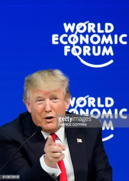 US President Donald Trump gestures as he speaks during a discussion during the World Economic Forum annual meeting on January 26 2018 in Davos...