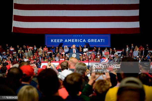President Donald Trump gestures as he speaks during a Keep America Great campaign rally in Tupelo, Mississippi, on November 1, 2019.