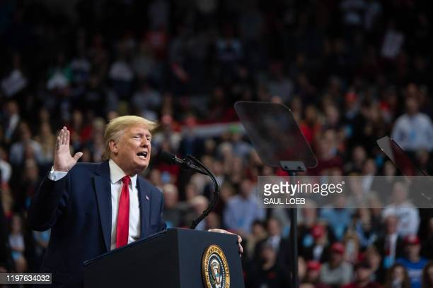 """President Donald Trump gestures as he speaks during a """"Keep America Great"""" campaign rally at Drake University in Des Moines, Iowa, January 30, 2020."""
