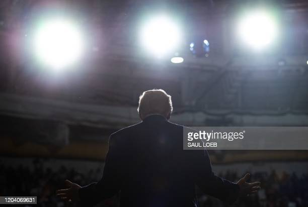 President Donald Trump gestures as he speaks during a Keep America Great campaign rally at the North Charleston Coliseum in North Charleston, South...