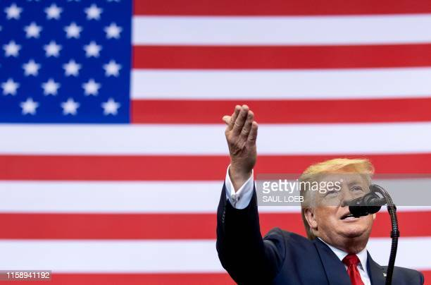 US President Donald Trump gestures as he speaks during a Make America Great Again campaign rally in Cincinnati Ohio on August 1 2019