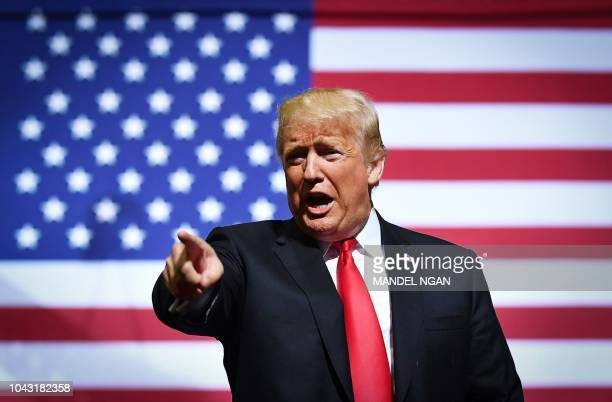 US President Donald Trump gestures as he speaks during a rally at WesBanco Arena in Wheeling West Virginia on September 29 2018