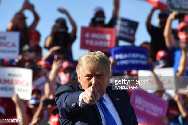 President Donald Trump gestures as he speaks during a rally at Carson City Airport in Carson City, Nevada on October 18, 2020.