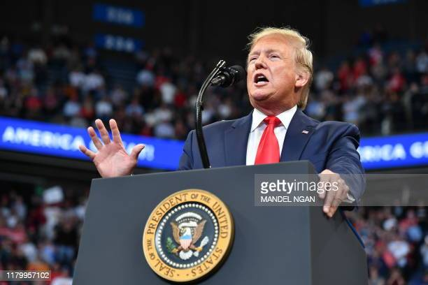 President Donald Trump gestures as he speaks during a rally at Rupp Arena in Lexington, Kentucky on November 4, 2019.