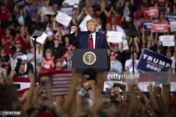 US President Donald Trump gestures as he speaks during a rally in Manchester New Hampshire US on Thursday Aug 15 2019 Trump arrived for a rally in...