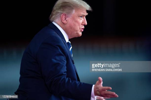 US President Donald Trump gestures as he speaks during an NBC News town hall event at the Perez Art Museum in Miami on October 15 2020