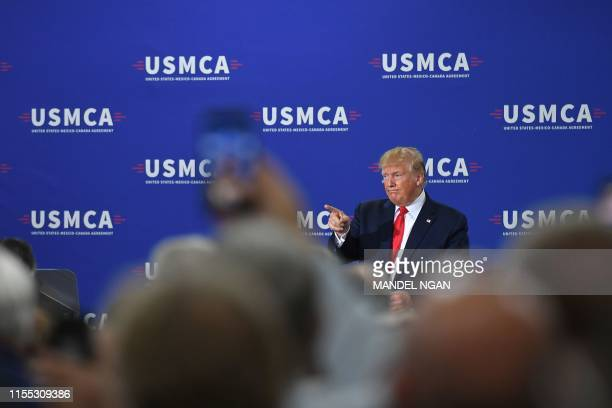 US President Donald Trump gestures as he speaks on the United StatesMexicoCanada Agreement trade agreement at Derco Aerospace Inc plant in Milwaukee...