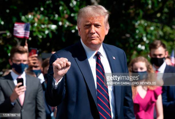 President Donald Trump gestures as he speaks to the press before walking to Marine One to depart from the South Lawn of the White House in...